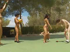Team of naked chicks playing outdoor