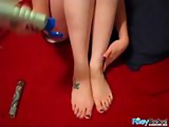 Naughty teen plays with her feet